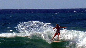 Surfing at Domes Beach